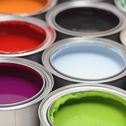 Open paint cans with various bright colors inside
