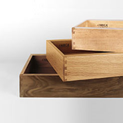 Stack of cabinet drawers in various wood species