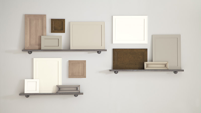 Various doors and drawer fronts in new cabinet stain and paint colors