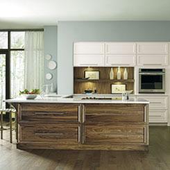 Wood kitchen cabinets in Natural Walnut and painted Maple & Cabinet Materials - Omega Cabinetry kurilladesign.com