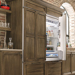 Refrigerator with wood panels to match the surrounding cabinetry
