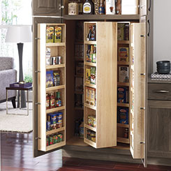 Tall pantry cabinet opened to show storage capabilities within