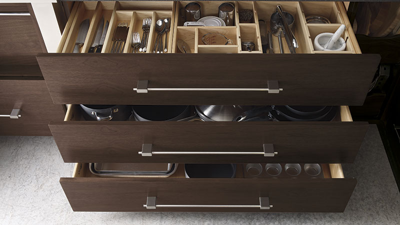 Cabinet drawers opened to show inserts for organization