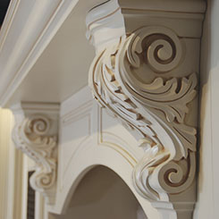 Ornate cabinet corbels in off white with glazed details