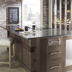 Torin Walnut kitchen cabinets with industrial-like metal accents