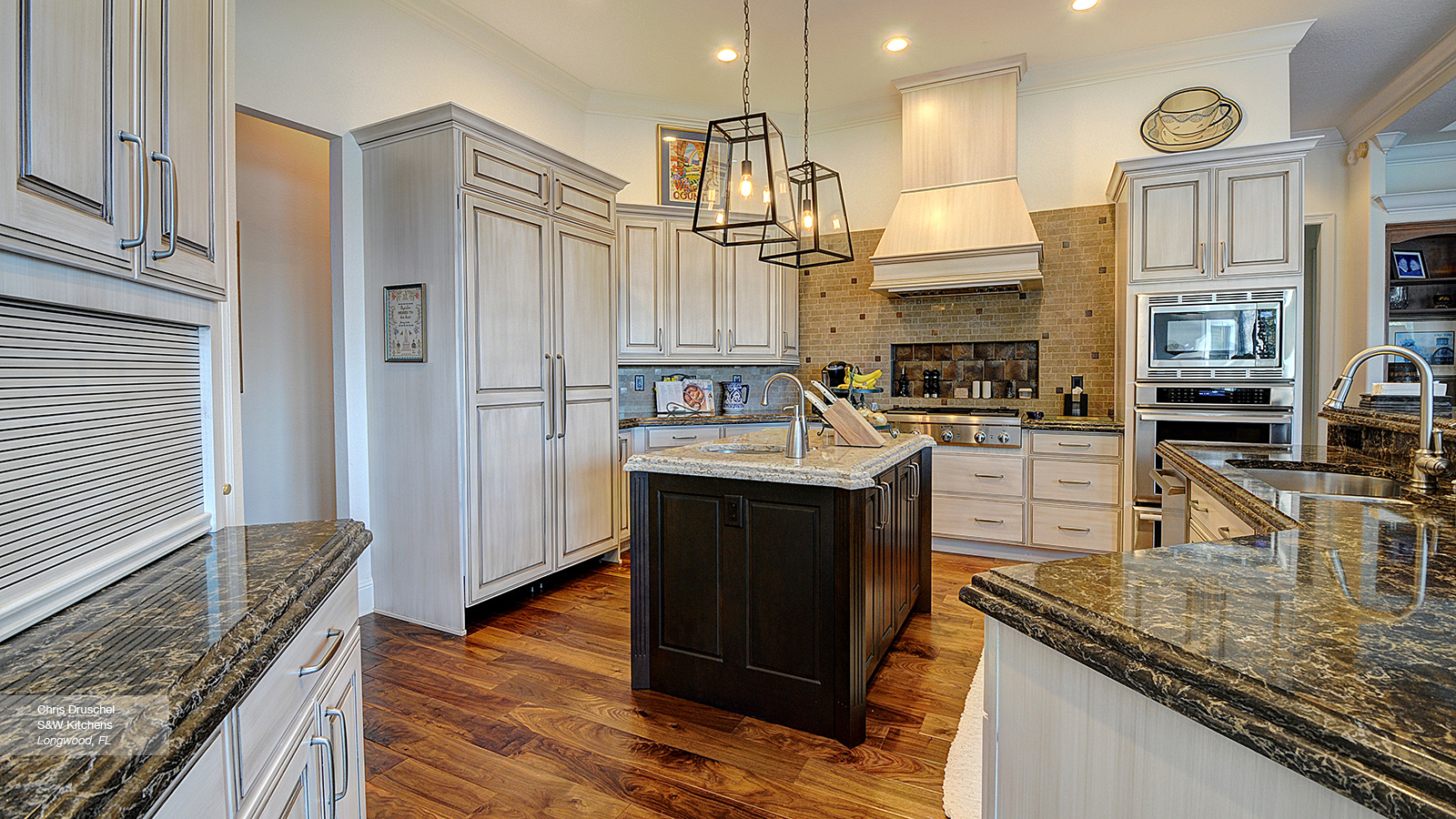 Off White Cabinets with a Dark Wood Kitchen Island - Omega