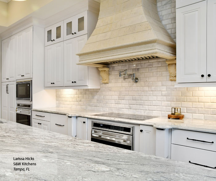 Close up of white cabinets in a traditional kitchen