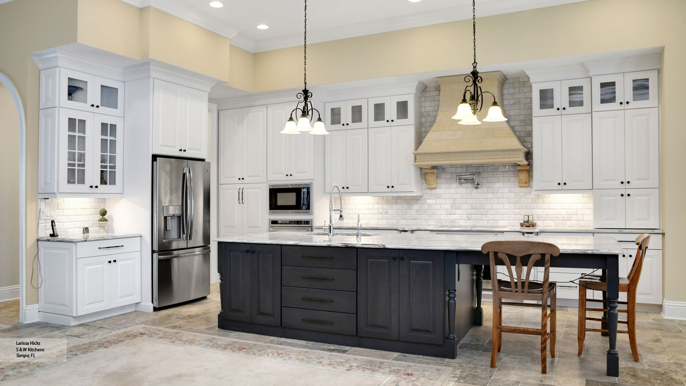 Kitchen with White Cabinets and a Gray Island - Omega