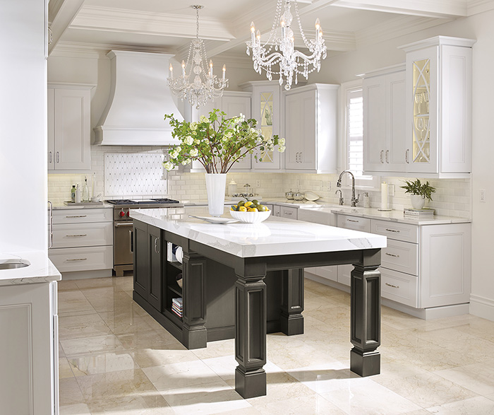White Kitchen Cabinets With A Dark Grey Island Omega