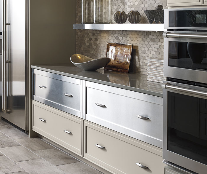 Close-up of Lyssa painted maple cabinets and stainless steel drawer fronts