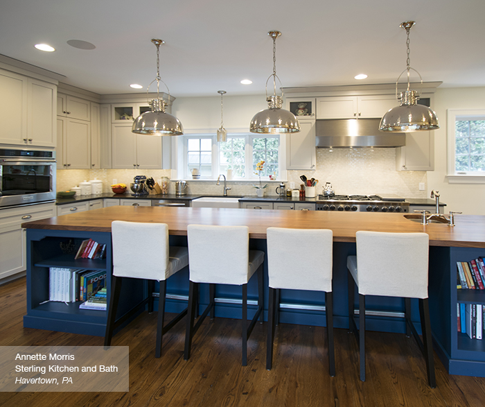 Puritan Off white cabinets in maple magnolia with a blue kitchen island blue lagoon