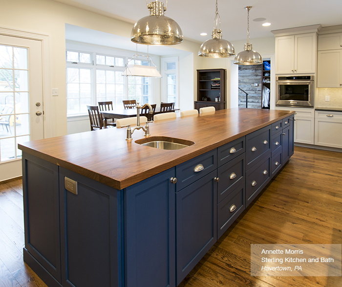 Off White Cabinets With A Blue Kitchen Island