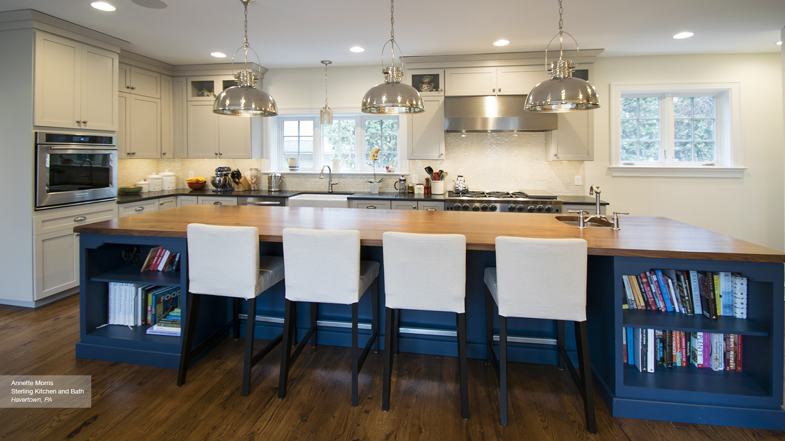 Off white cabinets with a blue kitchen island omega Omega kitchen design center