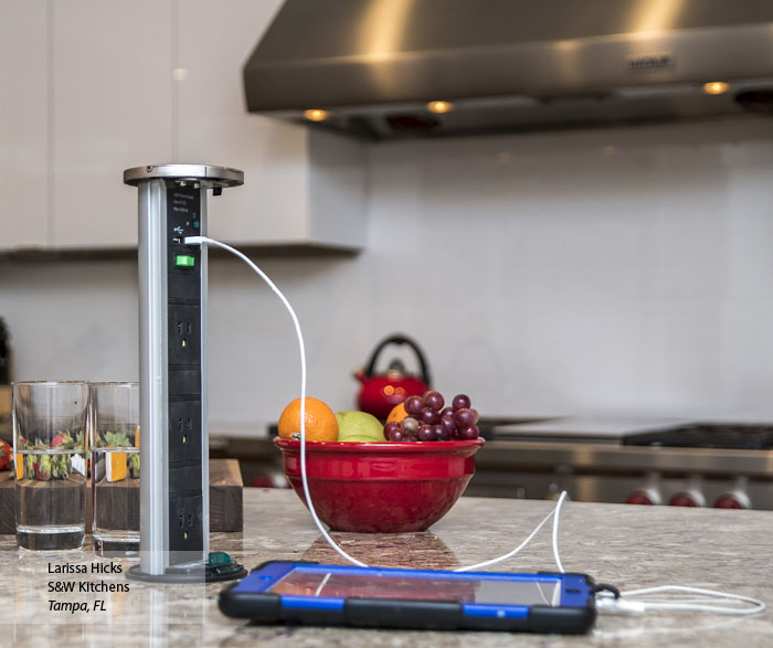 Cell phone being charged with a Sensio PowerPod in the kitchen island