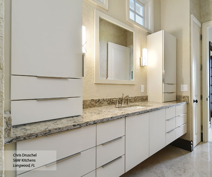 Modern bathroom with Vail slab cabinet doors in Maple Dove finish