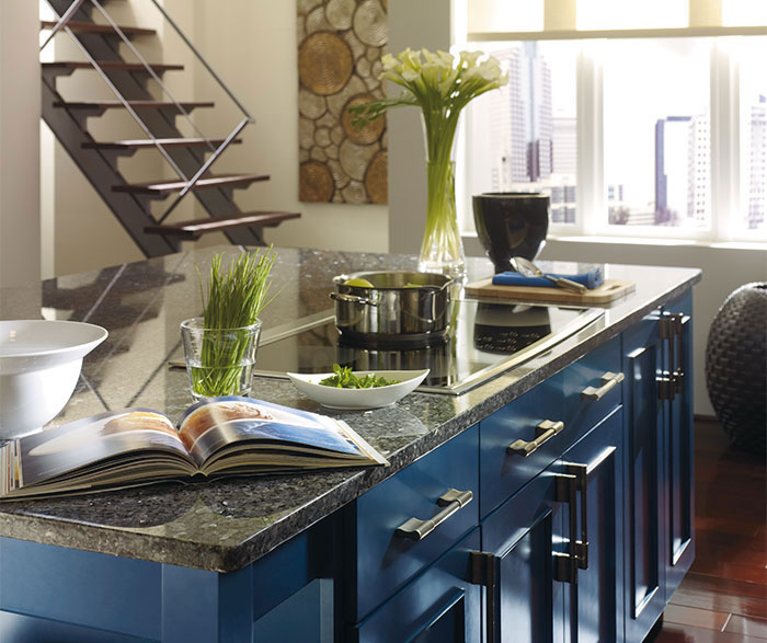 Dark wood cabinets with a blue kitchen island omega