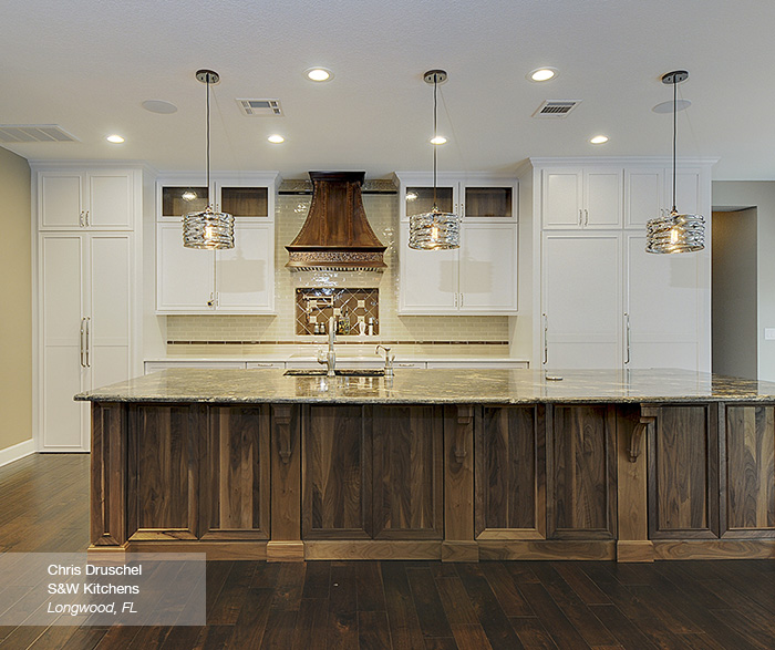 White cabinets with a walnut kitchen island omega Omega kitchen design center