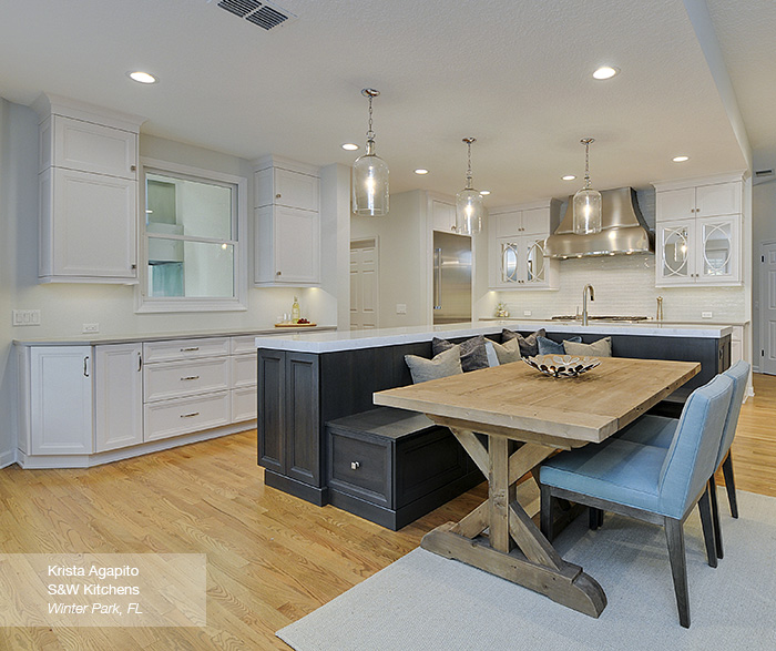 Cayhill kitchen cabinets in maple pearl featuring an Island with bench seating in walnut smokey hills