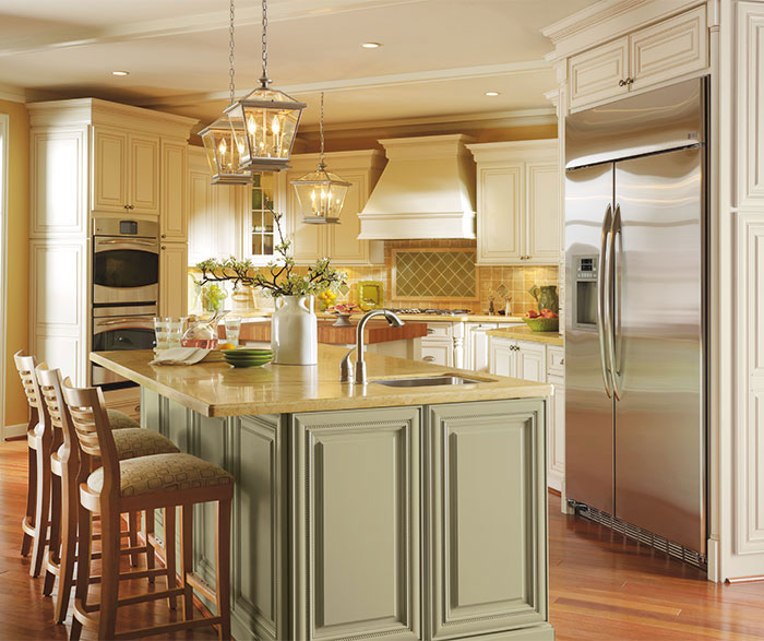 Melbourne off white cabinets in Oyster finish with Caramel glaze in a traditional kitchen