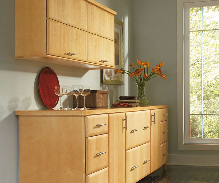 Close-up of Pennison dining room storage cabinets in Maple Honey finish
