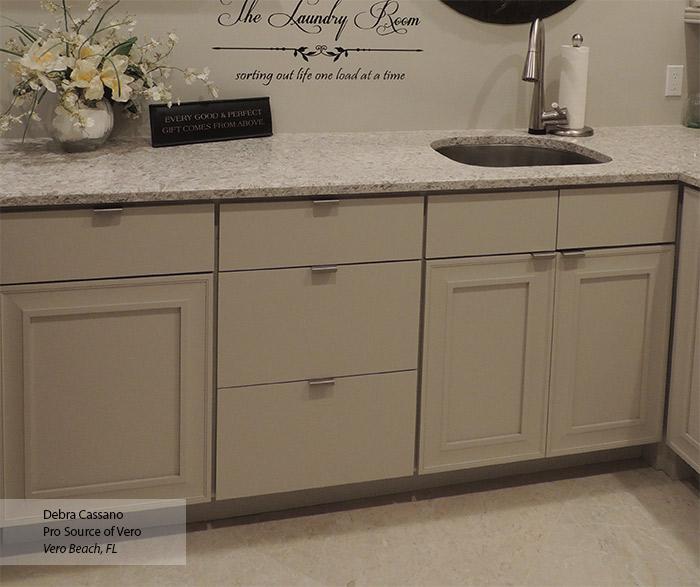 Perin laundry room storage cabinets in Maple Magnolia finish