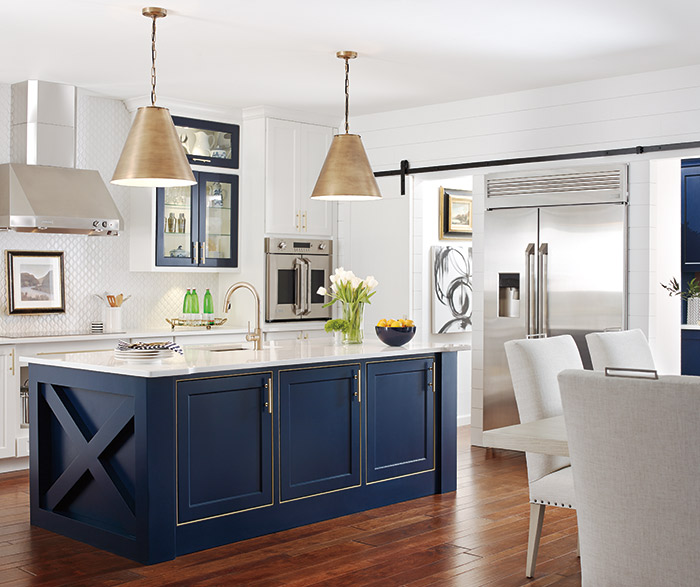 White kitchen with a custom blue kitchen island in the Renner door style