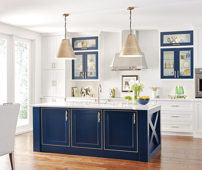 White kitchen cabinets with a custom blue kitchen island in the Renner door style