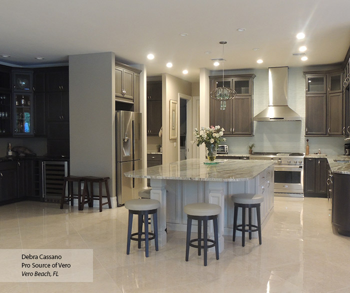 Ultima gray cabinets with an off white kitchen island and bar area