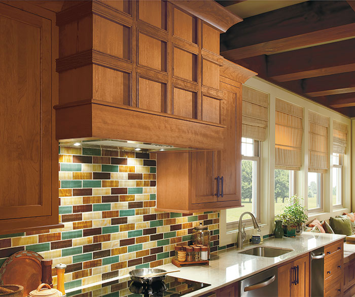 Close up of wood hood in rustic Ultima kitchen with Cherry wood cabinets